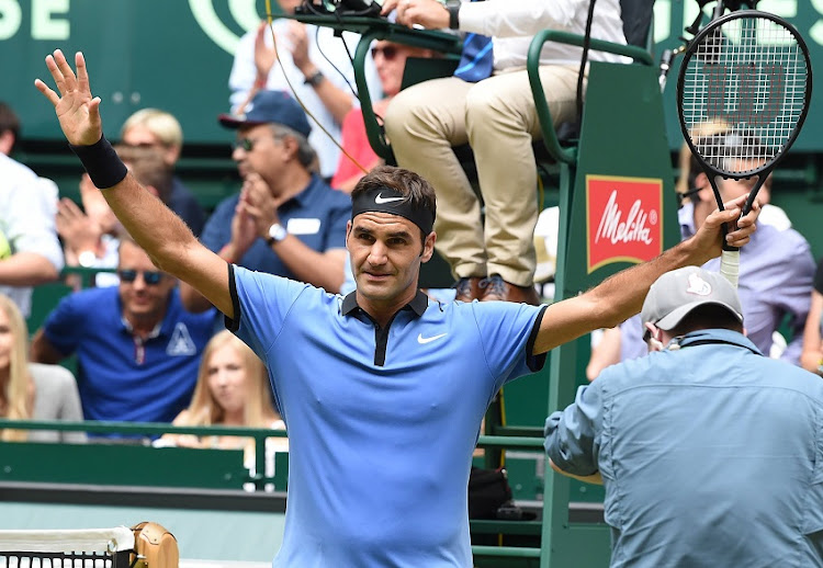 Roger Federer from Switzerland celebrates winning his match against Florian Mayer from Germany during the ATP tournament tennis match in Halle, western Germany, on June 23, 2017.