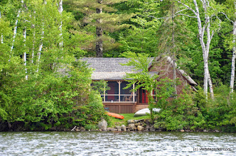 Photo: Perry Merrill cottage from the water at Ricker Pond State Park by Linda Carlsen Sperry