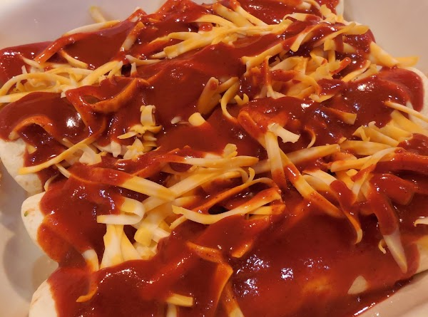 Once all the enchiladas are done and in the pan, sprinkle with cheese and...