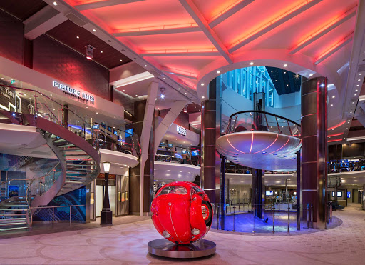 The Rising Tides Bar on Symphony of the Seas serves as a slow-moving elevator connecting the Royal Promenade and Central Park.