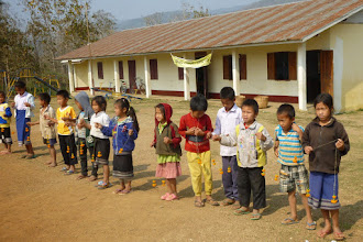 Photo: OAT supports this small village.  The government of Laos pays for high school, but not elementary school.  OAT built the building and pays the teacher.