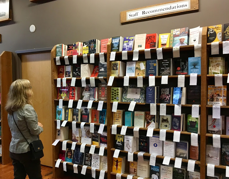 Find note cards on shelves with staff recommendations.