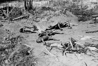 Photo: 1965, Vietnam --- Original caption: South Vietnam: The burned bodies of South Vietnamese children shown sprawled on ground after Viet Cong attack on village. --- Image by © Bettmann/CORBIS