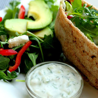 Veggie Feta and Arugula Pita Sandwich with Tzatziki Sauce.