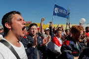 People protest against presidential election results during an opposition demonstration near a plant of the heavy off-road vehicles manufacturer MZKT in Minsk, Belarus August 17, 2020.