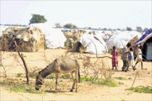 LURKING DANGER: German workers were kidnapped in this part os the Darfur state of Nyala. Pic.Sydney Seshibedi. 10/08/2008. © . ST The Kalma Refugee camp in Sudan's Southern Darfour state of Nyala. More than 85000 people live in the camp and the number encreases everyday. The IDP's left their villages, when the Arab Janjaweed Militia, attacked their villages. 10/08/2004 pic by sydney seshibedi
