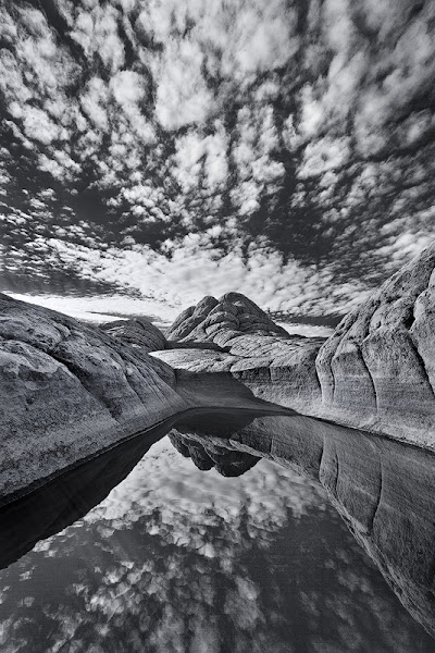 Photo: White Pocket in the Vermillion Cliffs National Monument is by far one of the most interesting places I have visited. On this particular day, these incredible clouds formed in the middle of the night and continued streaking across the sky for hours. It was a great night and morning for photography and just enjoying this incredible landscape.