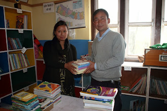 Photo: Shobha handing over the books to Dorje Sir Chilaune School.