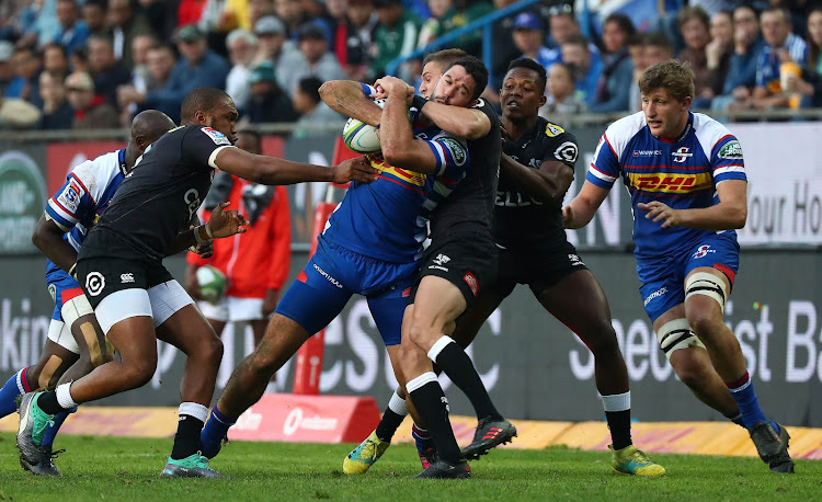EW Viljoen of the Stormers is tackled by Louis Schreuder of the Sharks during a Super Rugby match at Newlands Stadium, Cape Town on July 7 2018.