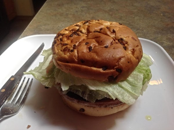 Add the fried bologna to the prepared bun, and top with other half.