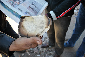Photo: Burnt pages of a book from the Institute d'Egypt, which stored thousands of rare and priceless books dating back several centuries until the building was badly burned during clashes between protesters and the army. Few Egyptians knew of the buildings contents until after it was burned and the books already destroyed beyond repair.