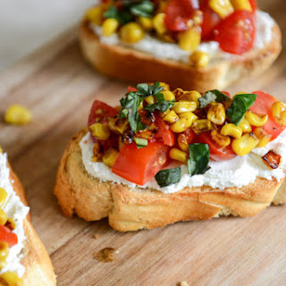 Summer Crostini with Whipped Roasted Garlic Goat Cheese.