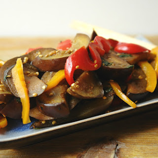 Wok - Eggplants with Orange and Red Bell Peppers.