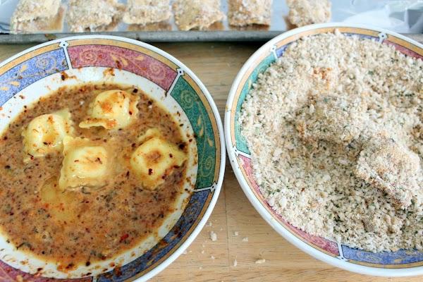 Dredging ravioli in egg wash and panko crumbs.
