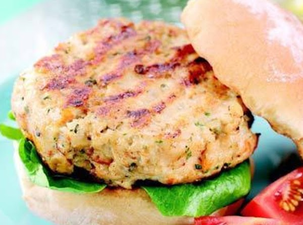 Place cooked burgers on slider or burger roll bottoms. Drizzle with about 1 Tbsp....