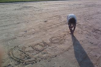 Photo: Kaleya draws her name in the sand