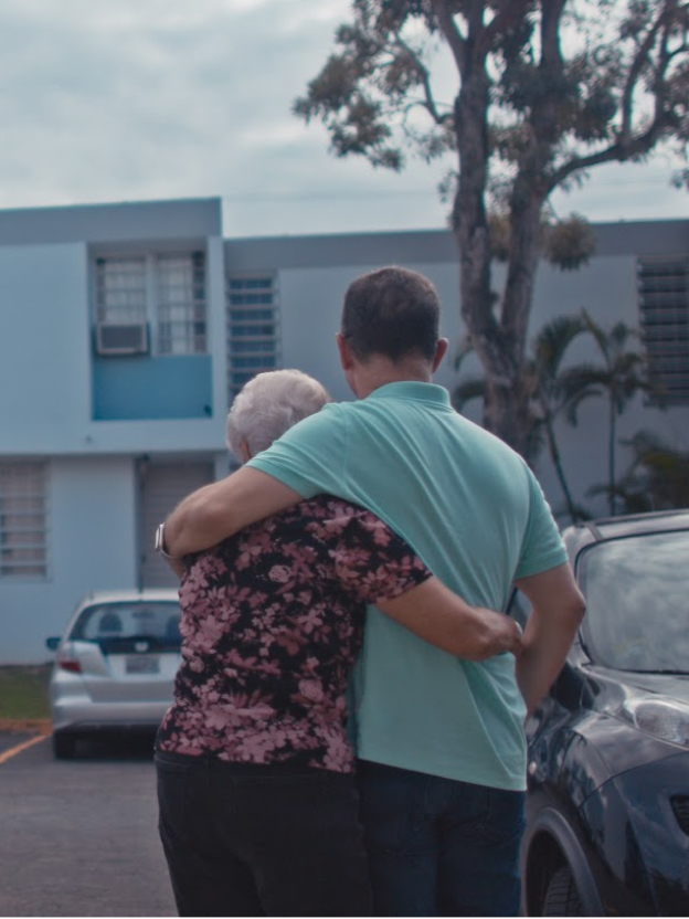 Googler with family member after a hurricane in Puerto Rico.