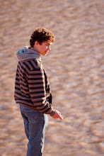 Photo: A bar mitzvah student, skipping rocks in the Colorado river.