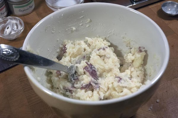 Partially mash with a potato masher, or fork.