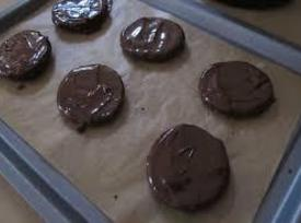 Meanwhile dip the cooled biscuits in the remaining melted chocolate, covering them completely (you...
