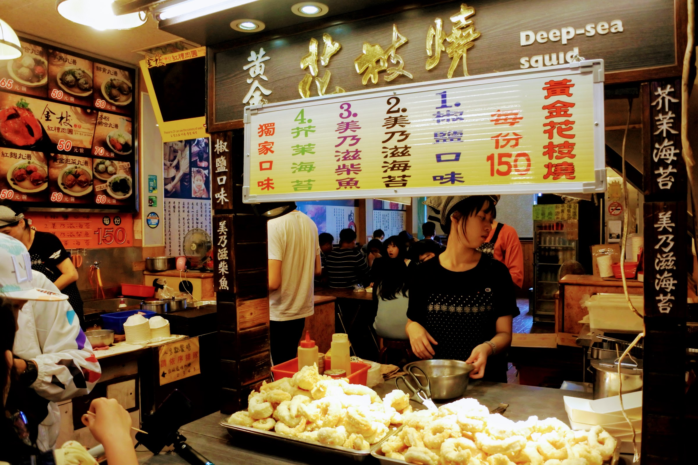 Try local food at Jiu Fen Old Street