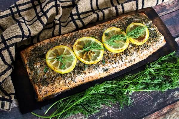 Cedar Plank Salmon With Dill And Lemon Slices.