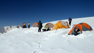 Photo: Campsite under new snow as Jose prepares the Ground Penetrating RADAR (GPR) equipment