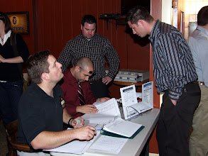 Photo: Patrick Albert, Georges Maamari, Stephen Lynch, with Craig Ogden signing in