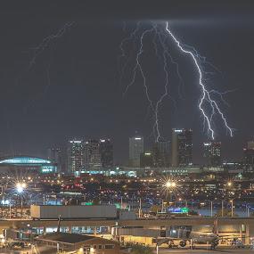 Two Bolts and the Phoenix Skyline by Bryan Snider - City,  Street & Park  Street Scenes ( airport, lightning bolts, skyline, lightning, desert, arizona monsoon, monsoon, thunderstorm, skyscrapers, sky harbor, arizona, buildings, weather, storms, phoenix, bolts,  )