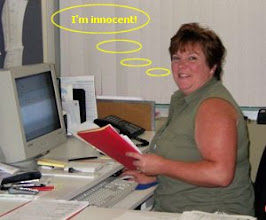 Photo: Cathy Godin plotting to fix the prize draw