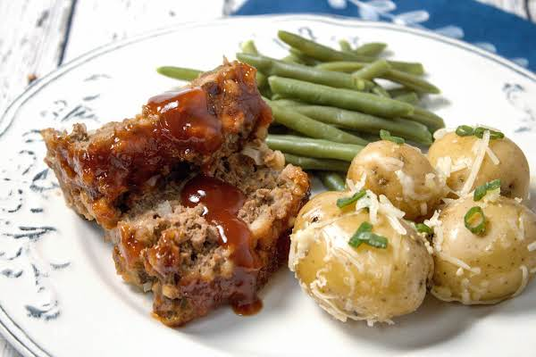 Slices Of Instant Pot Meatloaf With Potatoes And Green Beans.