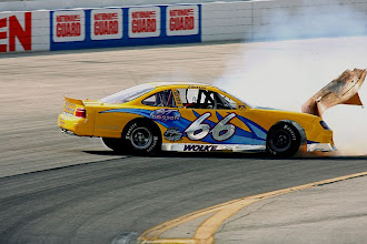 Photo: 66 blows his motor and the hood - Milwaukee Mile