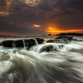 Sunset Beauty by Choky Ochtavian Watulingas - Landscapes Beaches ( seashore, waves, sunset, cloudy, beach, seascape, motion, rocks, skies )