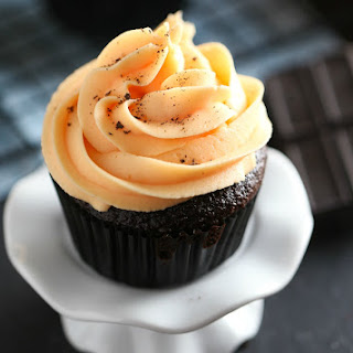 Chocolate Cupcakes with Orange Buttercream Frosting.
