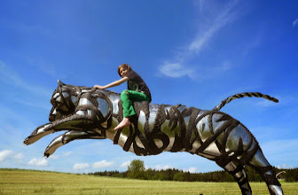 Photo: mixed media, Recycling steel and Tire Art, event photo option or playground toy - riding the tiger, 6 feet tall, 12 feet lenght, scrap stainless steel and varius used tires, perfect sculpture, www.mo-metallkunst.de