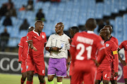 Referee Victor Hlongwane argues with players Free State Stars during the Absa Premiership match between Mamelodi Sundowns and Free State Stars at Loftus Stadium on November 07, 2018 in Pretoria, South Africa.