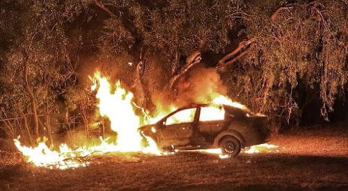 A stolen car burns on Hillam Avenue on Tuesday morning.