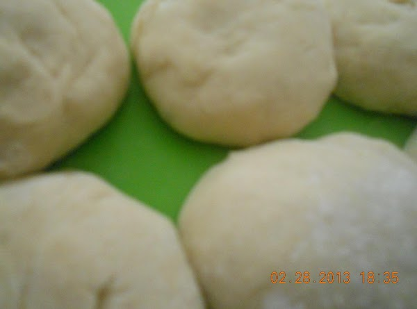 Pre heat the oven to 350*. Roll the dough balls into 1/2 -1/4 inch...