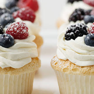 Angel Food Cupcakes with Whipped Cream and Berries.