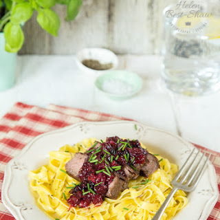 Ostrich Steaks with Red Berry Sauce & Pasta.