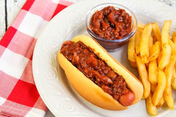 Hot Dog Onions On A Hot Dog With French Fries.