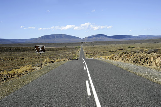 Highway passing through the Central Karoo region of SA near Matjiesfontein looking toward the Komsberge Mountains.