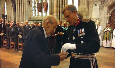 Photo: 2013 Lt Cdr Patrick Collis RN receiving his Arctic Star from the Lord Lieutenant