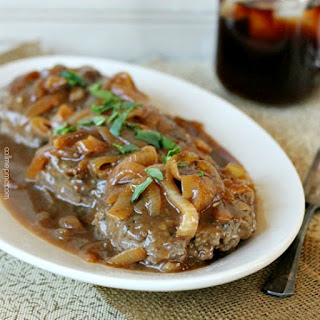 Hamburger Steak With Onions and Brown Gravy.