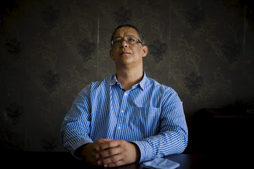 Ipid head Robert McBride says he is trying to track the 16 Hawks 'security guards' in the police system as they had effectively become 'ghosts'.