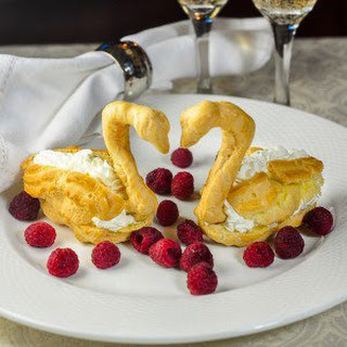 Profiterole Swans with Chantilly Cream and Raspberries