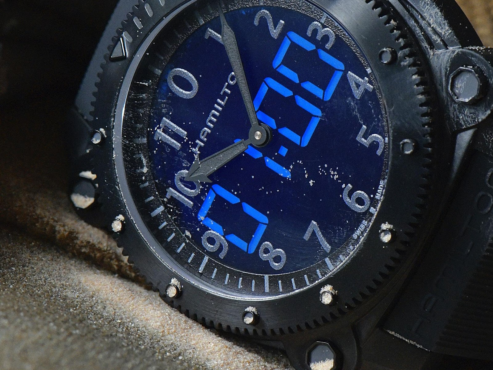 A picture containing watch, close  Description automatically generated