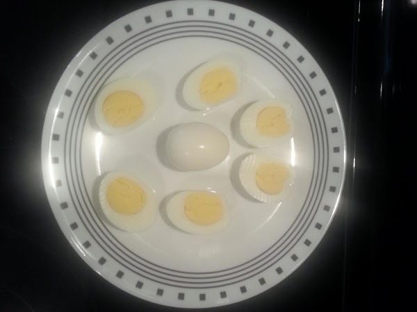 Dry eggs and slice long ways.