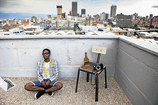 Moose Zulu, posing as a hipster, on the roof of trendy Main Street Life, in Johannesburg Picture and illustration: LAUREN MULLIGAN