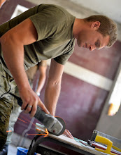 Photo: A member of the Croatian army cuts tile for a bathroom at an elementary school in Ogulin, Croatia, June 24, 2014. The school bathrooms are being renovated by Airmen from the 133rd and 148th Civil Engineering Squadron, and 219th RED HORSE Squadron in partnership with the Croatian army. Croatia is a Minnesota state partner under the National Guard State Partnership Program. (U.S. Air National Guard photo by Staff Sgt. Austen Adriaens/Released)